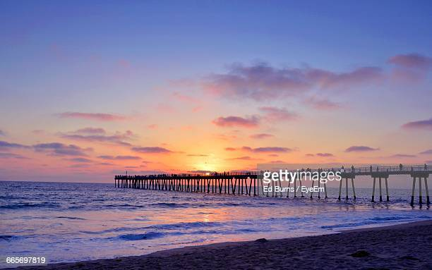 silhouette of pier on river - hermosa beach stock pictures, royalty-free photos & images