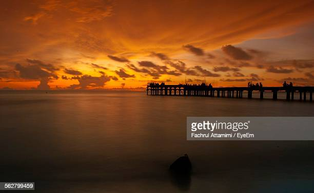 Silhouette Of Pier Over Sea Against Majestic Sky