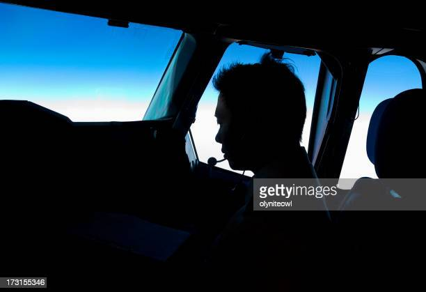 Silhouette of Pilot in Cockpit