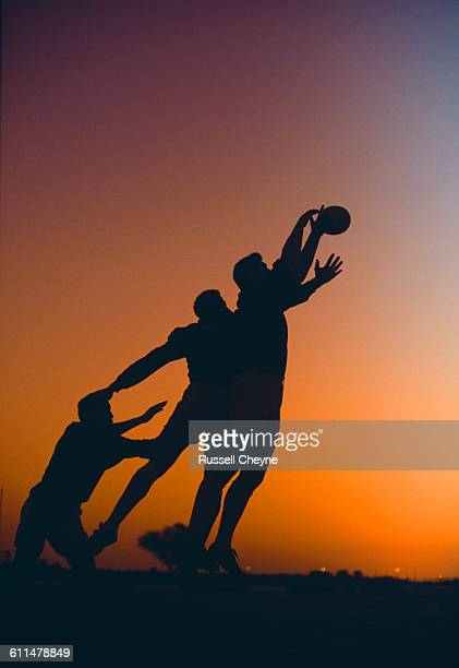 Silhouette of players from the Stade Toulousain reaching for the ball during the Dubai Rugby Sevens on 2 December 1990 at the Dubai Exiles Rugby...