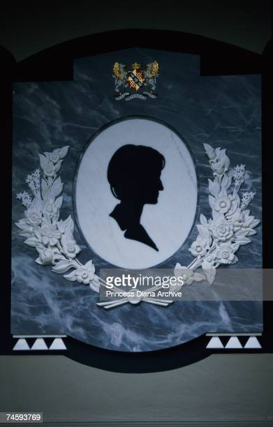 A silhouette of Princess Diana on a marble plaque on her grave and memorial at the Spencer family home at Althorp Park Northamptonshire July 1999