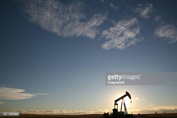 Silhouette of Pumpjack on the Great Plains