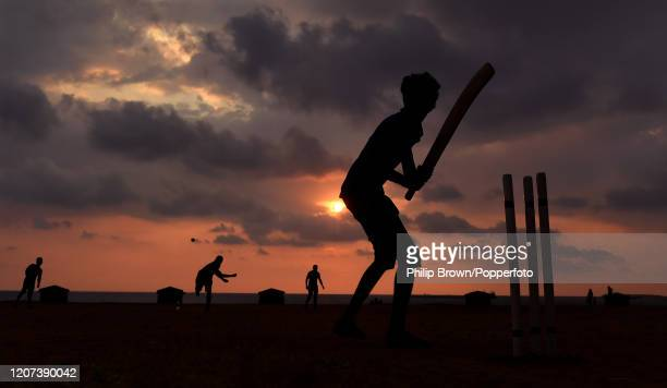 Silhouette of Punitha Raja batting during a cricket game on Galle Face Green in Colombo at sunset on the 16th March 2020. The Test match series...