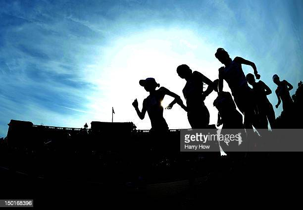 Silhouette of race walkers competing in front of Buckingham Palace during the Women's 20km Walk final on Day 15 of the London 2012 Olympic Games on...