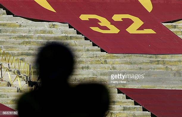 A silhouette of Reggie Bush of the USC Trojans is seen in front of the retired jersey of USC alumnus OJ Simpson against the UCLA Bruins December 3...