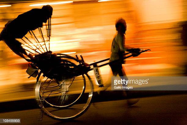 Silhouette of rickshaw in motion at night, Arashiyama, Kyoto, Honshu island, Japan