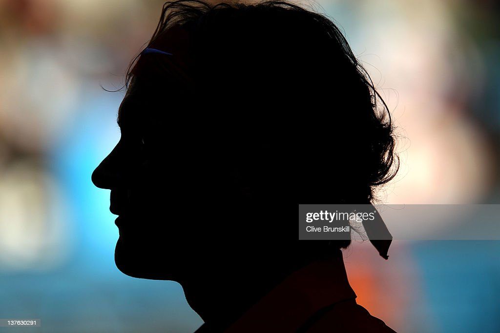 A silhouette of Roger Federer of Switzerland during his quarter final match against Juan Martin Del Potro of Argentina during day nine of the 2012 Australian Open at Melbourne Park on January 24, 2012 in Melbourne, Australia.