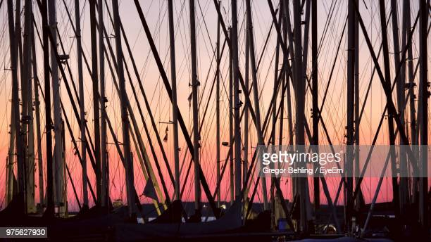 Silhouette Of Sailboat Against Sky At Night