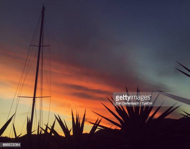 Silhouette Of Sailboat Against Sky During Sunset