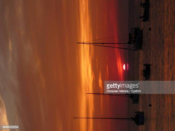 silhouette of sailboats in sea during sunset - marica octavian stock photos and pictures