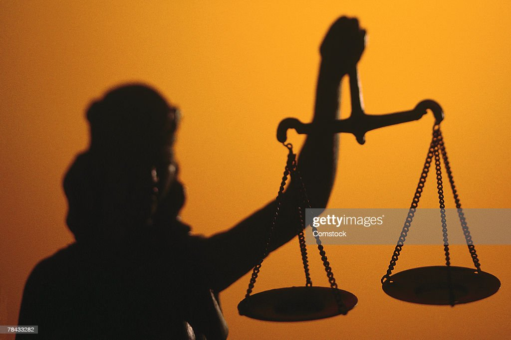 Silhouette of scales of Lady Justice holding scales : Stock Photo