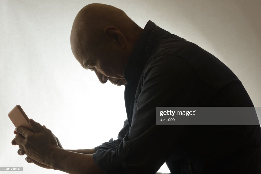 Silhouette of seniors with worries : Stock Photo