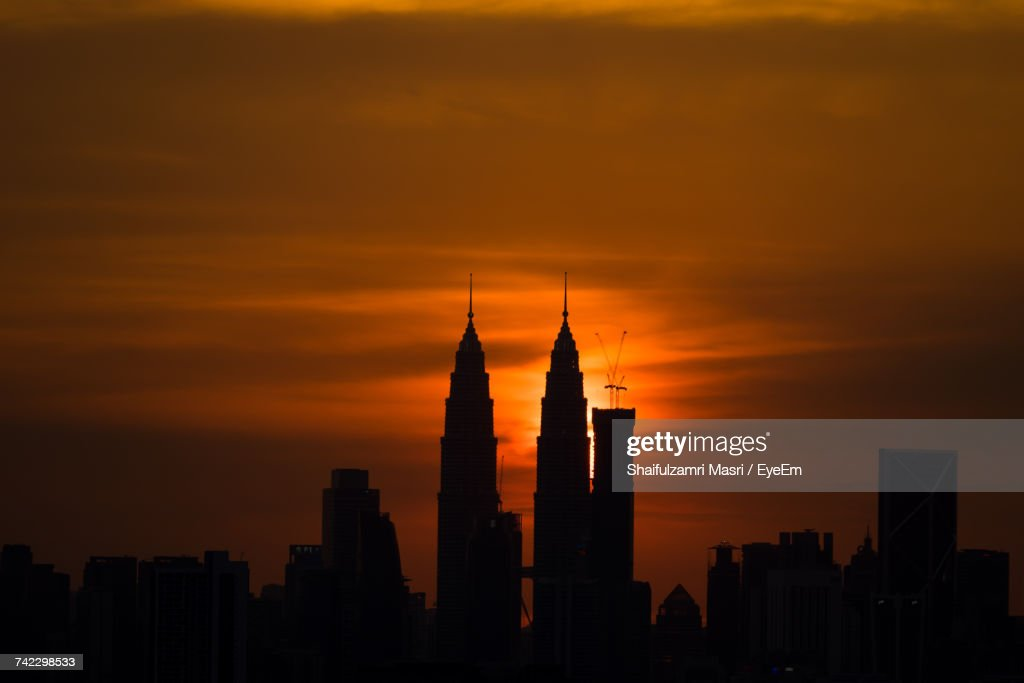 Silhouette Of Skyscrapers At Sunset : Stock Photo