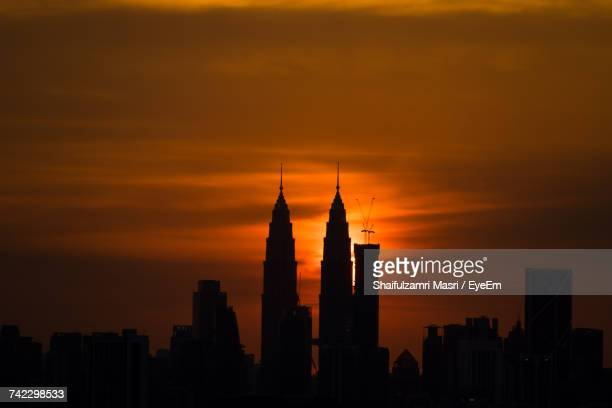 Silhouette Of Skyscrapers At Sunset