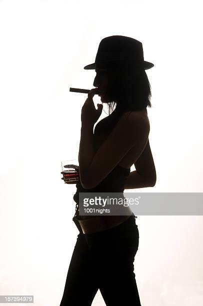 silhouette of smoking woman - beautiful women smoking cigars stock photos and pictures