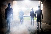 Silhouette of soccer teams facing field
