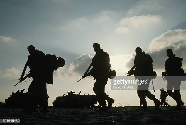 silhouette of soldiers - army soldier stock pictures, royalty-free photos & images
