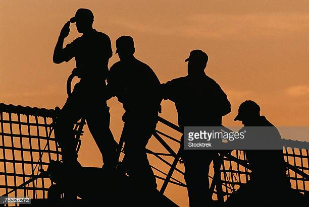 Silhouette of soldiers saluting flag, Kittery, Maine