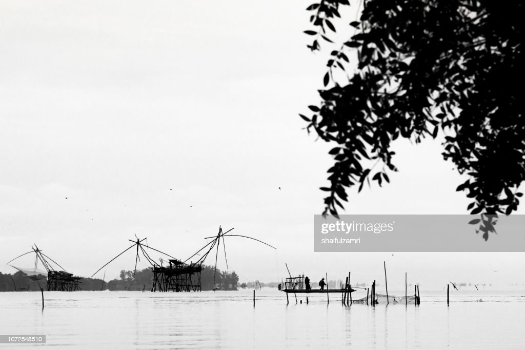 Silhouette of square dip nets with cloudy sky at Phatthalung. : Stock Photo