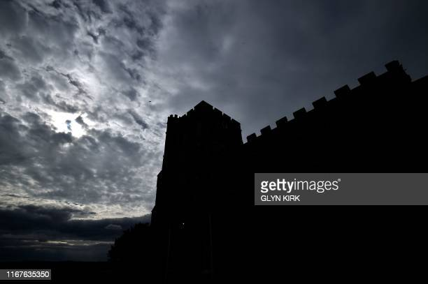 A silhouette of St Mary's Church where guests can pay to stay overnight in what is known as 'champing' is pictured in Edlesborough Buckinghamshire on...