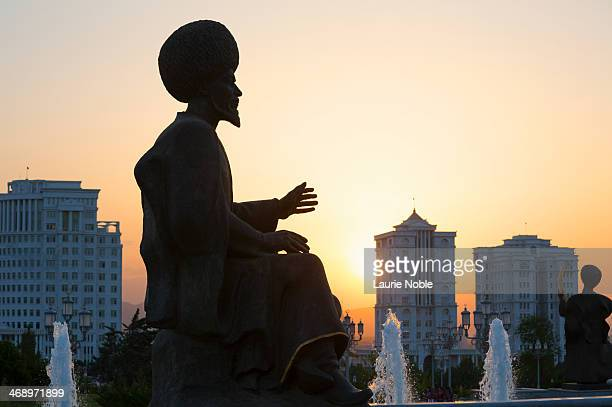 silhouette of statue at sunset, independence park - ashgabat stock pictures, royalty-free photos & images