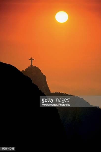 Silhouette of statue of Jesus Christ at sunset, Rio de Janeiro, Brazil