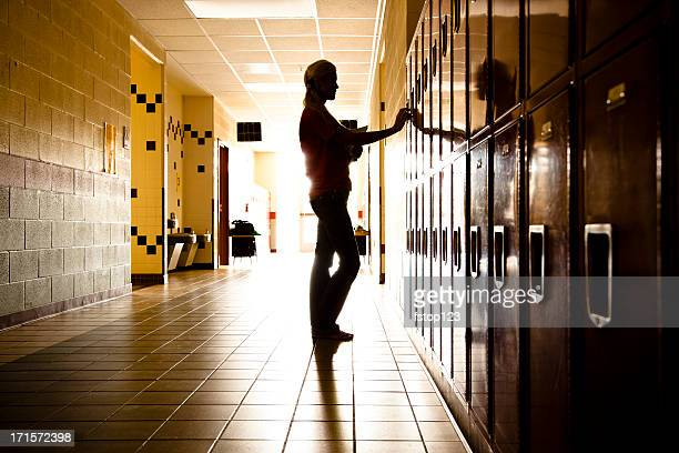 Silhouette of Student in hallway. Lockers. High school. Girl. Education.