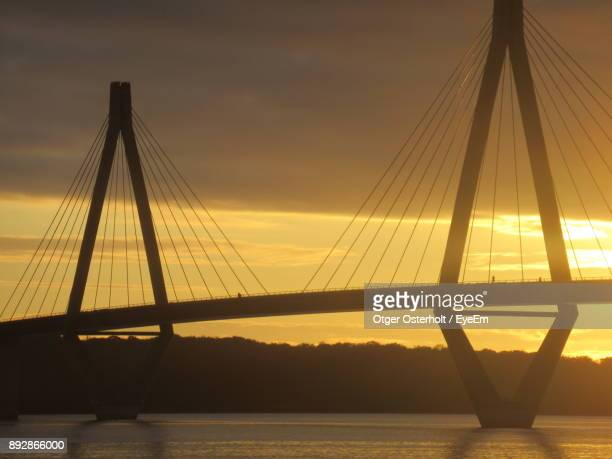 Silhouette Of Suspension Bridge Against Sky During Sunset