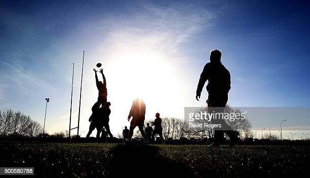 A silhouette of the Saints practicing their lineouts during the Northampton Saints training session held at Franklin's Gardens on December 9 2015 in...
