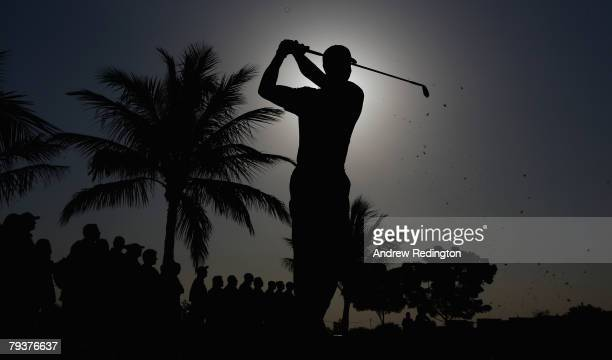 A silhouette of Tiger Woods of USA as he tees off on the fourth hole during the ProAm for the Dubai Desert Classic on the Majilis course at Emirates...
