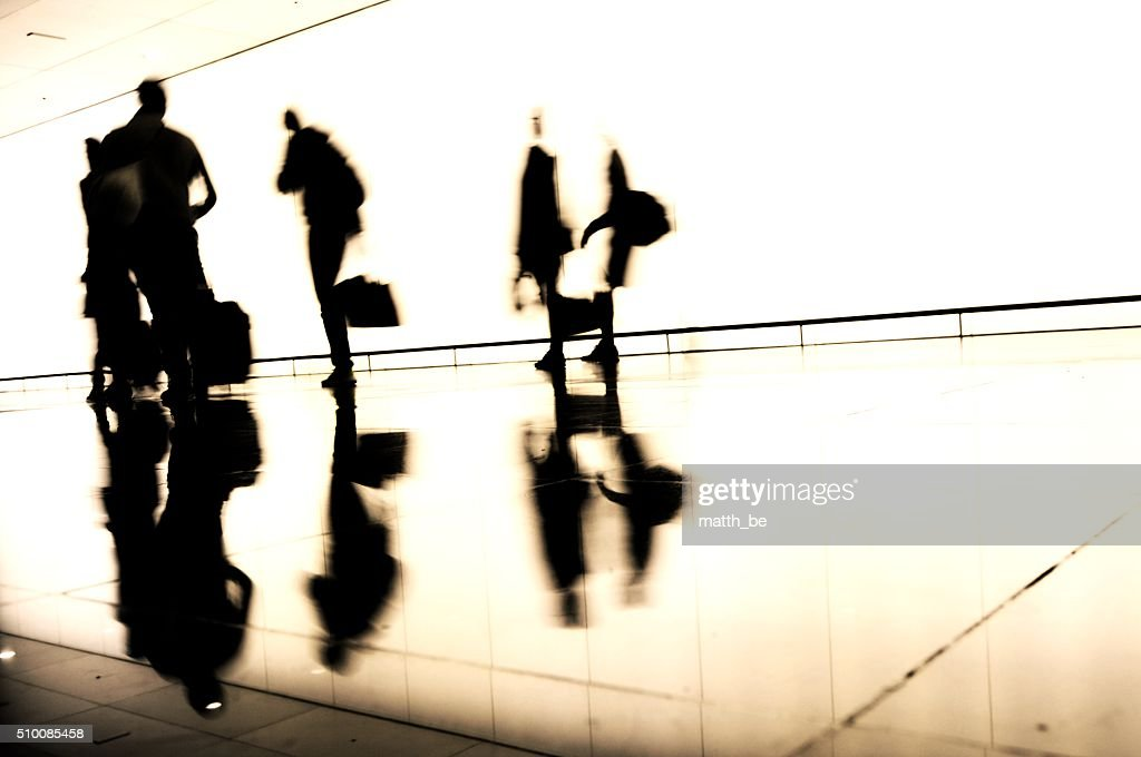 Silhouette of traveling people