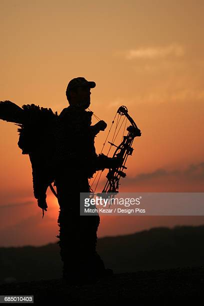 silhouette of turkey hunter - turkey hunting stock photos and pictures