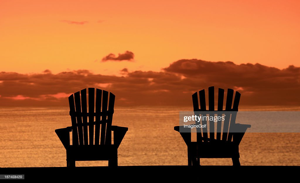 Silhouette Of Two Adirondack Chairs On The Beach : Stock Photo