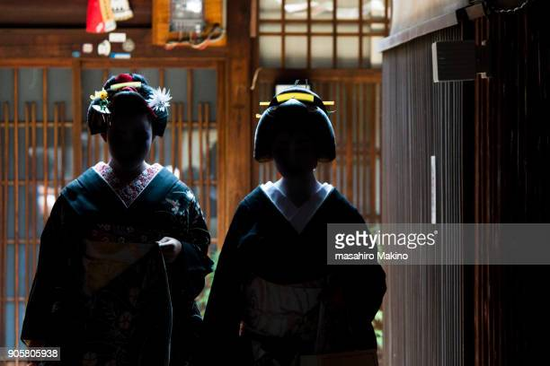Silhouette of Two Geishas