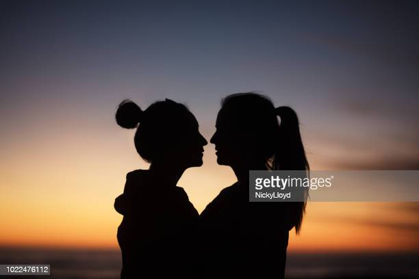 Free teen lesbian sex while standing Lesbians At Sunset Silhouette Photos And Premium High Res Pictures Getty Images