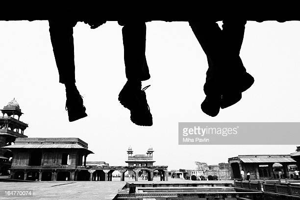 silhouette of two men - fatehpur sikri stock pictures, royalty-free photos & images