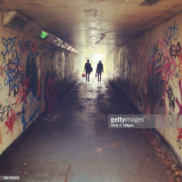 silhouette of two people in an underpass - coventry stock pictures, royalty-free photos & images