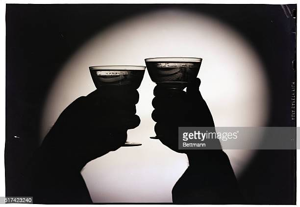 Silhouette of two toasting wine glasses Undated photograph