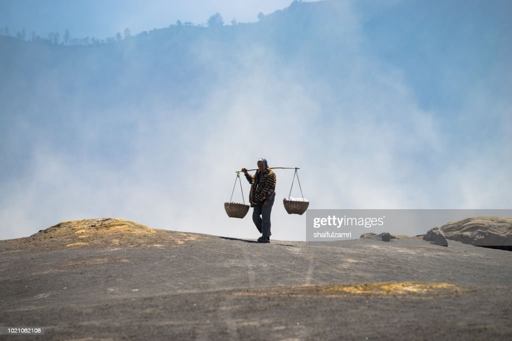 Silhouette of unidentified local people at the mountainside of Mount Bromo, Semeru, Tengger National Park, East Java of Indonesia. : Stock Photo