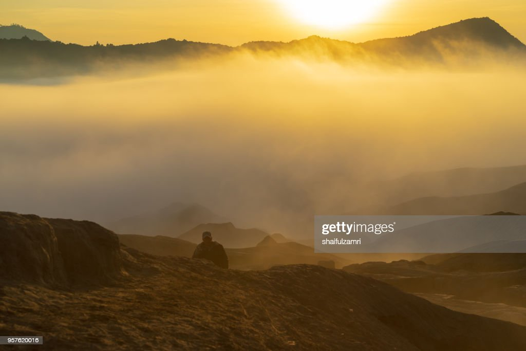 Silhouette of unidentified local people or Bromo Horseman at mountainside of Mount Bromo, Semeru, Tengger National Park, Indonesia : Stock Photo