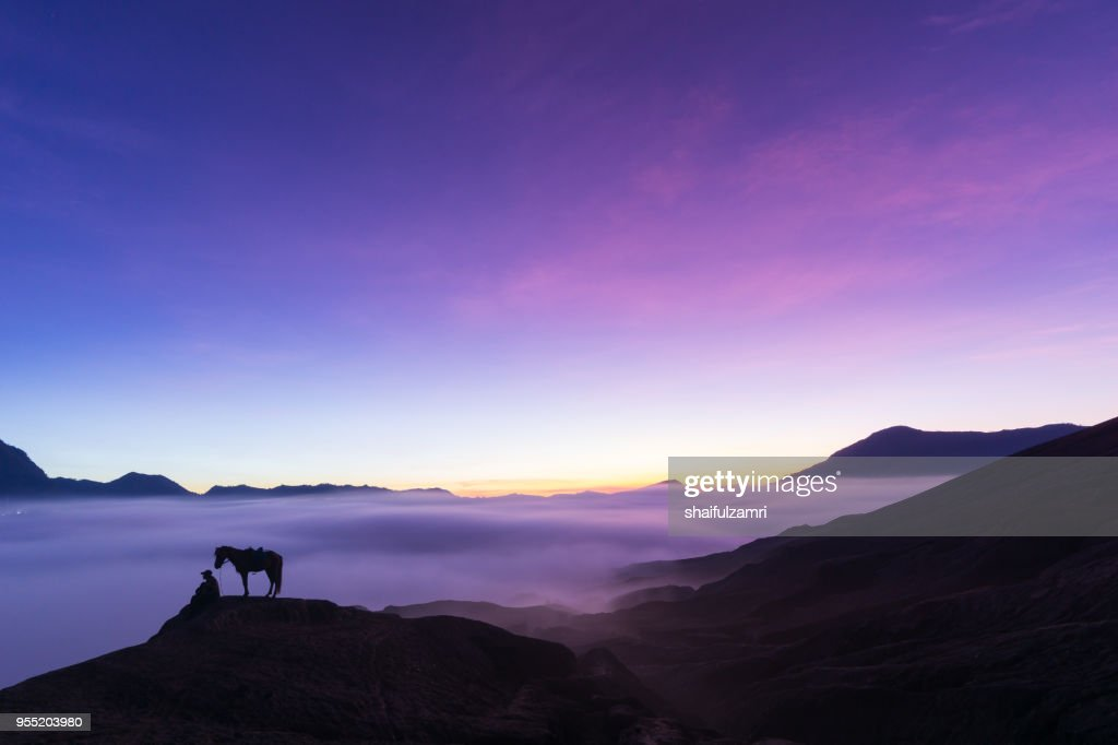 Silhouette of unidentified local people or Bromo Horseman at the mountainside of Mount Bromo, Semeru, Tengger National Park, East Java of Indonesia. : Stock Photo
