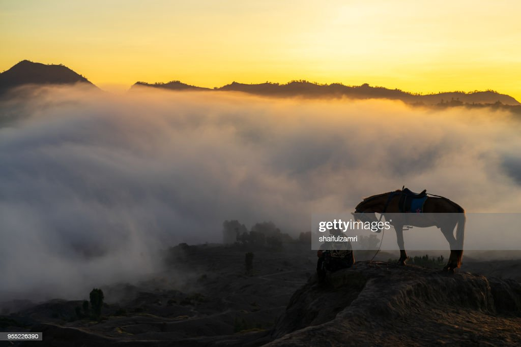 Silhouette of unidentified local people or Bromo Horseman at the mountainside of Mount Bromo, Semeru, Tengger National Park, Indonesia. : Stock Photo