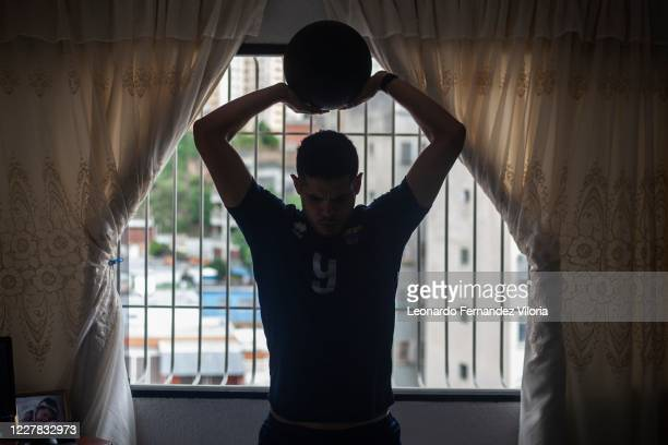 A silhouette of Venezuelan player Jose Chema Carrasco as holding the medicine ball over his head while training in isolation in his 70 square meter...
