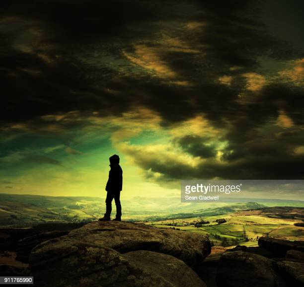silhouette of walker stood at the top of hill - peak district national park stock pictures, royalty-free photos & images