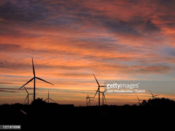 silhouette of wind turbines at sunset - northamptonshire stock pictures, royalty-free photos & images