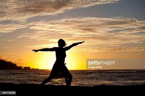 Silhouette of Woman Doing Yoga Beside Ocean