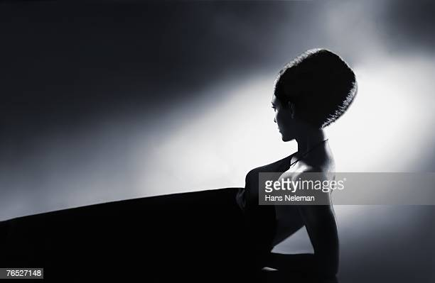 Silhouette of woman lying down