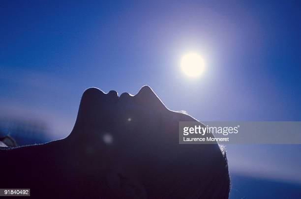 silhouette of woman lying down - lying down stock-fotos und bilder