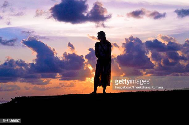silhouette of woman on beach at sunset - imagebook stock pictures, royalty-free photos & images
