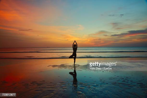 Silhouette Of Woman On Beach During Sunset